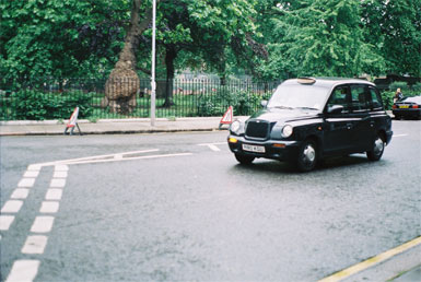A London cab passing Coram's Fields, London