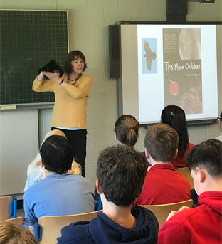 Bev presenting to students in Montreal, Quebec